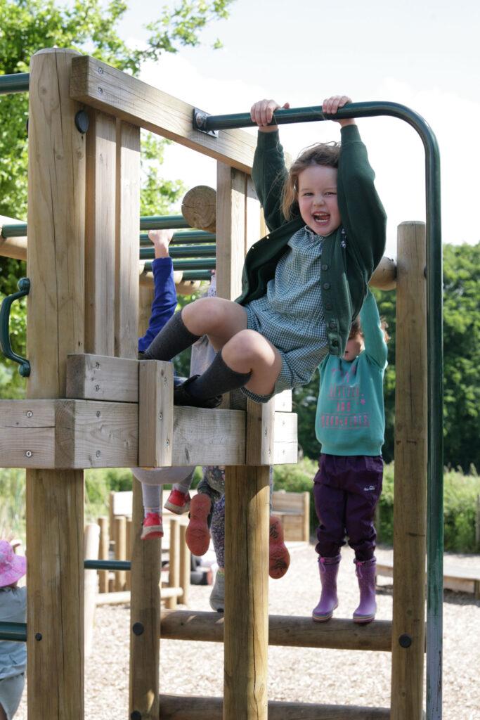 Girl in uniform in playground