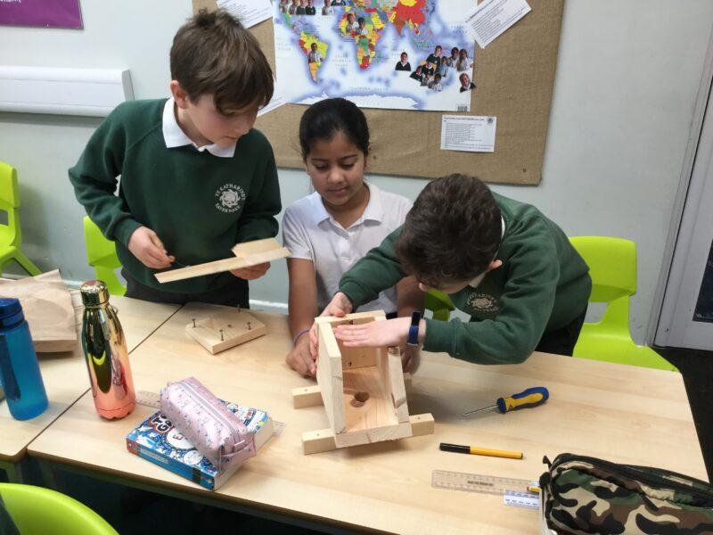 Children building a dormouse nesting box