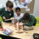 Children building a dormouse nesting box
